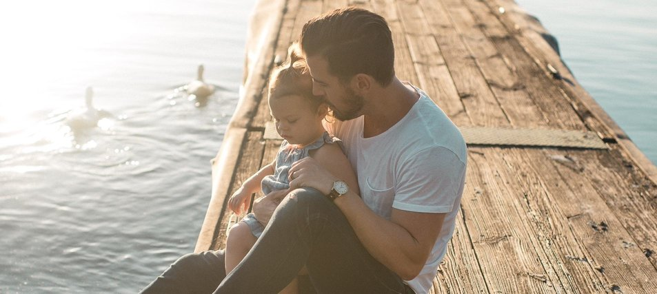 man with child on dock